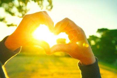 sun shining through hands