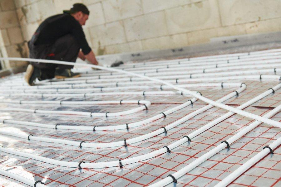 man installing underfloor heating